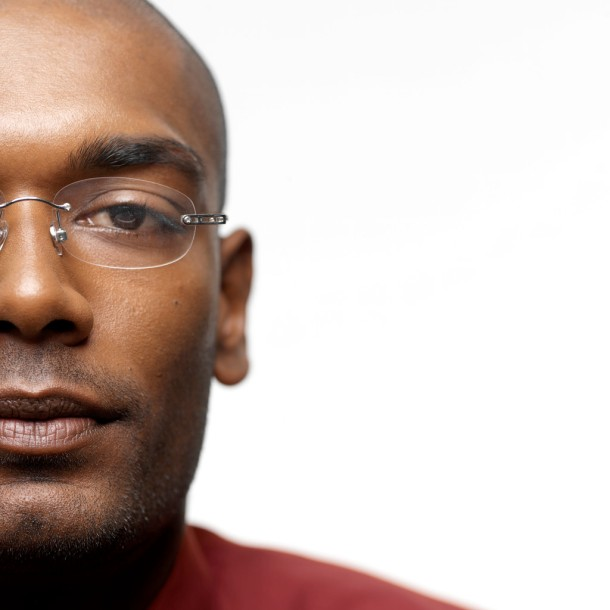black man with glasses